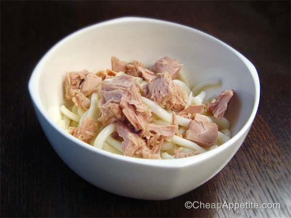 Add drained tuna to noodles.