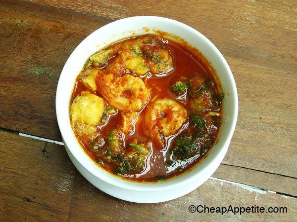 Gaeng Som (Sour Curry) with deep fried egg veggies and shrimp