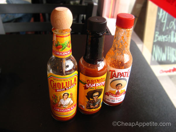 Cholula, Gringo Bandito, and Tapatio mexican hot sauces at Chronic Tacos