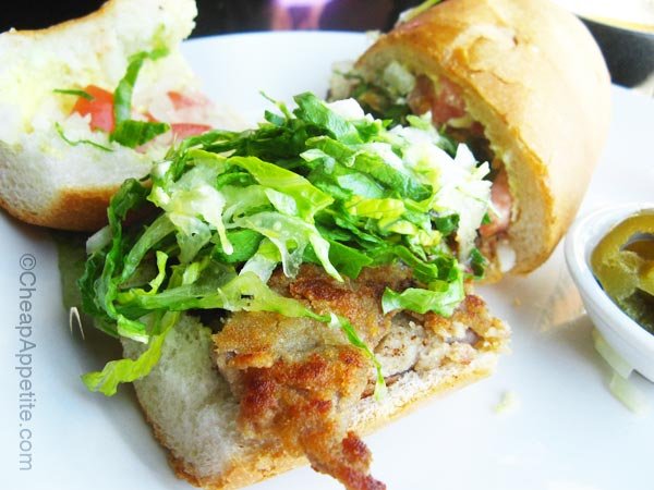 Mexican sub sandwich with fried breaded beef at Salsa Agave